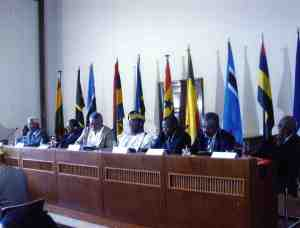 Jerry Rawlings taking notes at the high table