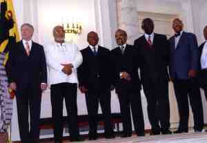 Ghana makes history by being the first country to have two former heads of state at a African Presidential Roundtable, namely J.J. Rawlings (centre with white shirt), and J.A. Kufuor third perdon  to the right of  Jerry Rawlings.