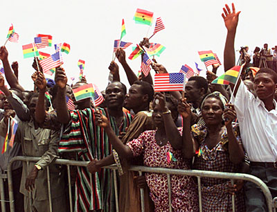A cheering crowd greets President Bill Clinton, and President Jerry John Rawlings, at the President's address in Independence Square, Accra, Ghana.
