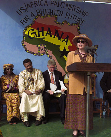 Mrs. Hillary Rodham Clinton makes remarks to the Peace Corps Techno/Serve Group with Mrs. Mrs. Hillary Rodham Clinton makes remarks to the Peace Corps Techno/Serve Group with Mrs. Nana Konadu Agyeman  Rawlings, and President of Uganda, Jerry John Rawlings and President Bill Clinton on the stage behind her.