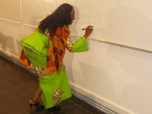 Nana Konadu illustrated her address by drawing a table showing the structure of the DWM. Her fluid movements drew admiration from her husband.