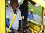 President Rawlings operating the weed harvester