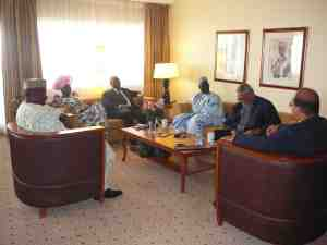 Former President Rawlings held meetings with the Nigerian Minister of Interior (on his riight) and other delegates prior to the start of Saturday's session