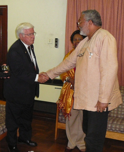 President Rawlings is introduced to Congressman Henry Brown
