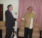 President Rawlings in a warm handshake with Ambassador Peter Jones after the meeting