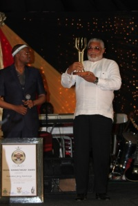 President Rawlings after receiving his trophy