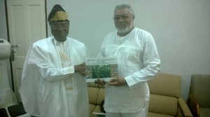 President Soglo presents a book on the Sasakawa projects to President Rawlings