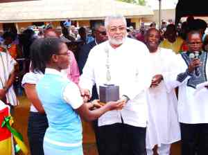 President Rawlings presented the best in marching award. Behind him is Dr Bernard Glover