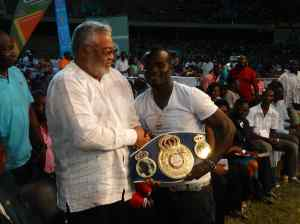 Joshua Clottey presented his WBA International Lightmiddleweight title to President Rawlings