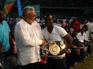 Joshua Clottey presented his WBA International Lightmiddleweight title to President Rawlings