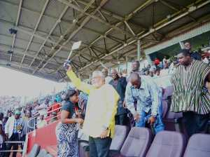 The former President waves the national flag in support of the Stars