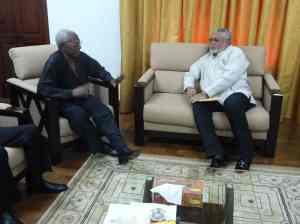 Leader of delegation Col (rtd) Gbagonah explains a point to President Rawlings