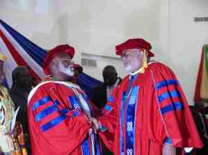 Former President Abubakar congratulates President Rawlings after he delivered the acceptance speech