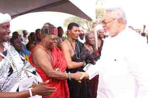 President Rawlings in a warm handshake with Nii Dodoo Nsakie